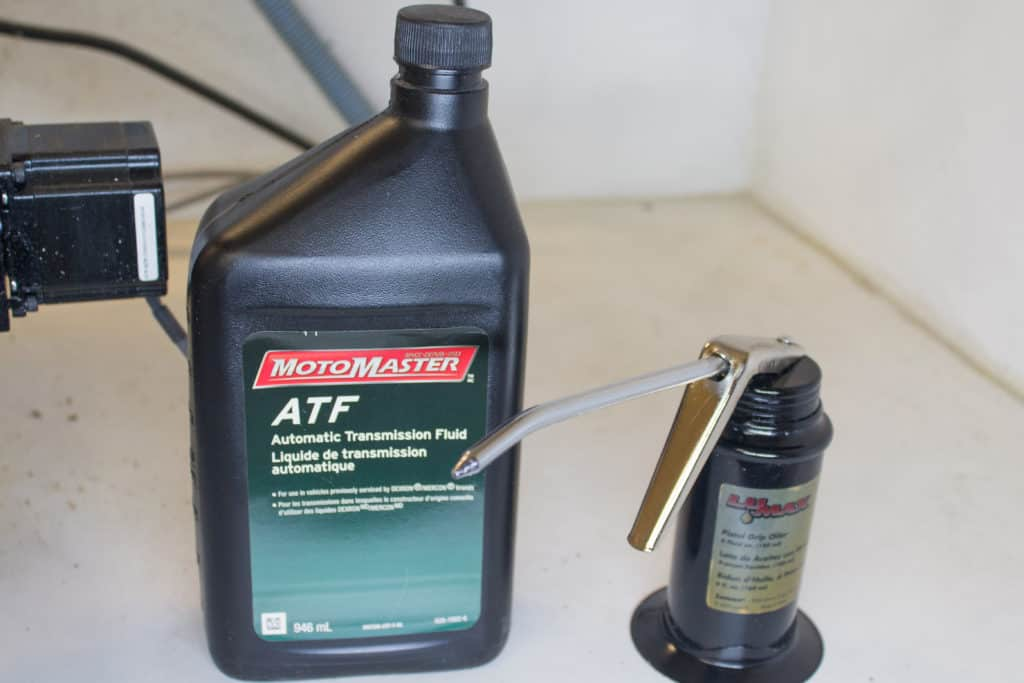oil can and a quart of oil