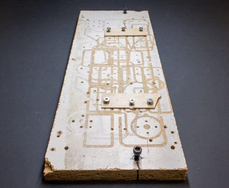 A wooden fixture plate
