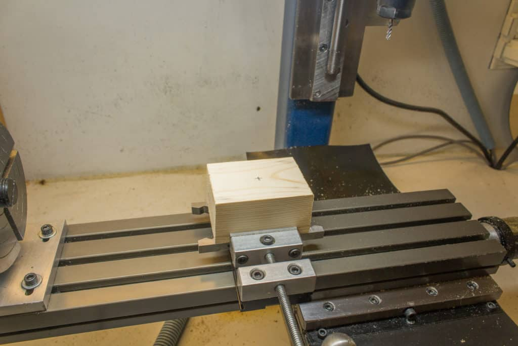 wood billet gripped in vice
