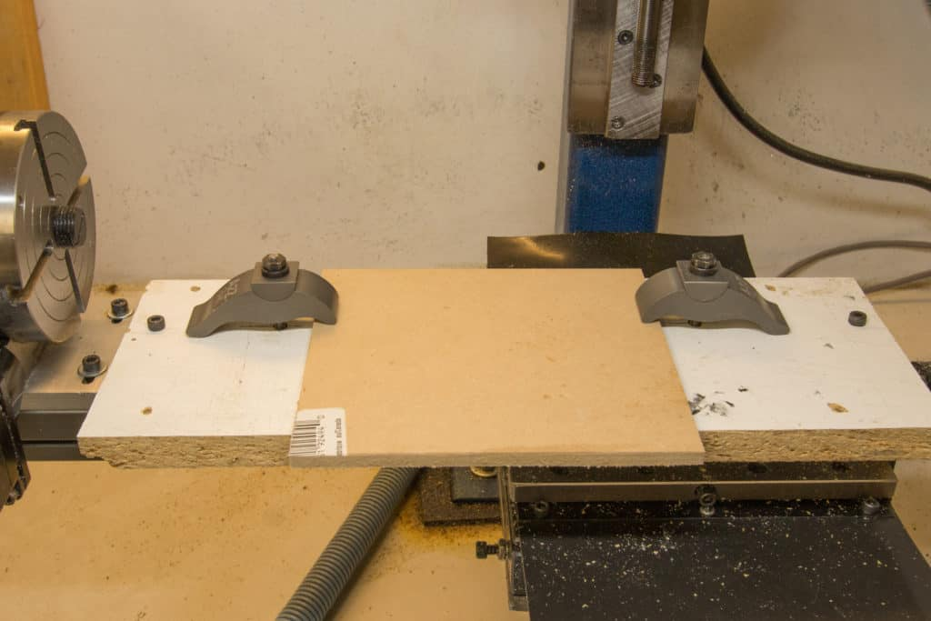 blank stock clamped to cnc mill