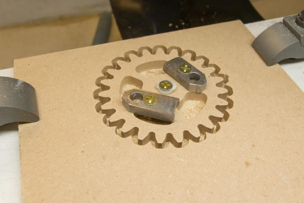 finished gear still clamped on the cnc machine